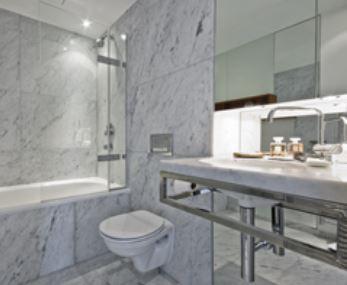 Grey marble tiled bathroom design