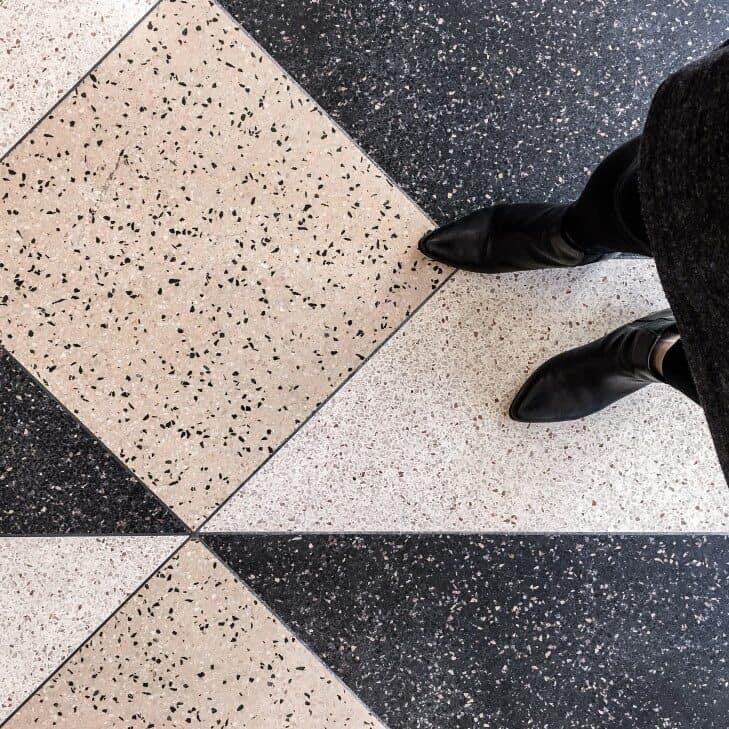 person on terrazzo flooring