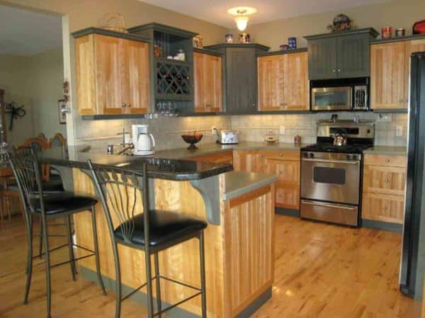 Pine effect fitted kitchen with island